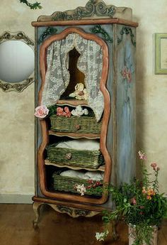 What a great way to change an old, perhaps broken, cupboard into a piece of art.