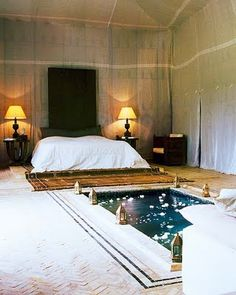 bohemian luxury // tented room // soft glow lighting // muted walls // soaking tub in the bedroom