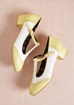 Anywhere You Tango T-Strap Heel in Yellow - Eight-count step through your daily adventures in these dance-ready heels - a ModCloth exclusive. Blending ivory uppers with pastel yellow accents and perforated details, these low, faux-leather T-straps keep you 'tango-ing' strong throughout a delightful day!