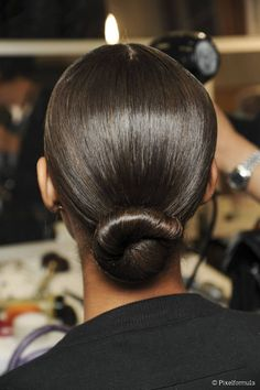 10 Best Updos to Protect Your Hair in Winter: Sleek Low Bun.
