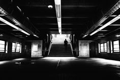 To the platforms - Underground station in Berlin Prenzlauer Berg. A man goes up the stairs to the platforms alone. Black and white street photography. #berlin #photography #street #streetphotography blackandwhite #fineart #subway