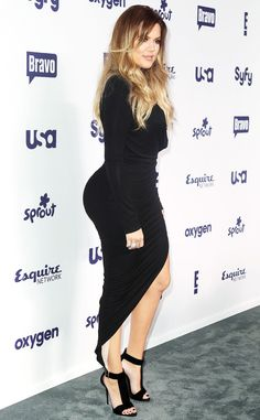 Khloé Kardashian shows off her curves in this black number!