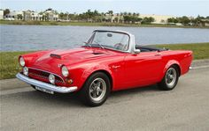 1966 SUNBEAM TIGER. 289 V-8. Hard to keep tires on this car. It deserved its name.