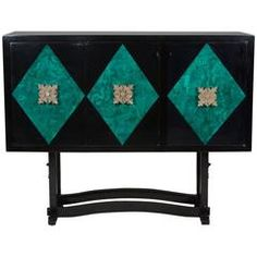 Black lacquered three-door bar, with malachite patterned diamonds on door faces, large elaborate bronze pulls. The case mounted on four legs with low arced stretchers. The center and left doors opening to reveal a revolving mirrored tiered bar unit, with brass, white laminate and walnut. The right door opening to reveal an interior storage area with single shelf, American, 1980s. Measures: Length 57 1/4 in, depth 21 in. Overall height 45 1/2 in. Height of case only 27 in.