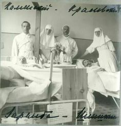 """Grand Duchesses Olga and Tatiana Nikolaevna Romanova of Russia as Sisters of Mercy with wounded soldiers. """"AL"""""""