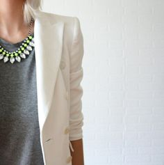 A statement necklace and tailored blazer amps up a plain tee.