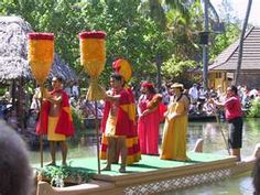Parade of the canoes at Polynesian Cultural Center --Ohau, Hawaii representing the dancing and costumes of 7 different Polynesian cultures.