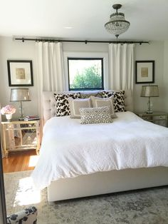 Neutral bedroom. Window behind bed. Bedroom window treatments. Paint is Benjamin Moore winds breath
