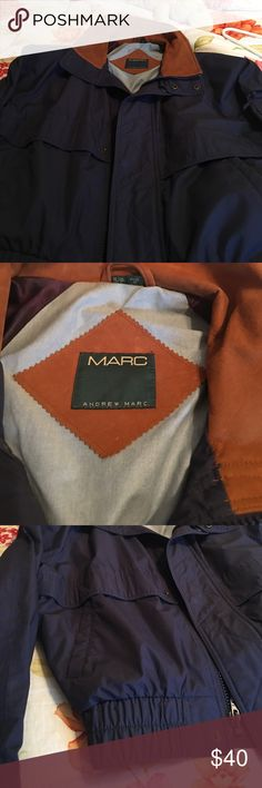 Andrew Marc bomber jacket Men's small navy with suede collar. Extra grimmest for snaps in inside pocket. . No heavy lining, but appears to be wind proof . Super nice jacket!  Excellent condition Andrew Marc Jackets & Coats Windbreakers
