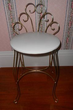 My Mom and I each had a vanity dressing table and chair set when I was growing up....the chairs were just like this one...