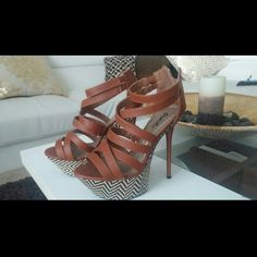 Brown Strappy High Heels Nice and tall high heels that are pefect for a date or a night out. Worn only twice :) Message me with any questions! Shoes Heels