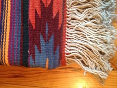 These stunning rugs are made from natural hand dyed wools using plant and aniline dyes. They are made in Michoacan Mexico by hand using wooden loomes by an artisan group. They are thick lush wool and just simply beautiful under foot. The Grande size is a beautiful size for most spaces,under a table or in a sitting area. It woul also be great for a bedroom.The Grande measures 1.32m x 1.98mDry Clean or Hand Wash OnlyWe currently have the one piece available but we are ge...