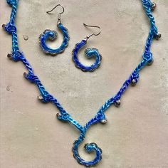 More swirls! This time with hand-dyed silk.  #mixedmediajewelry #crochetjewelry #bluehappiness