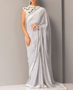 Embroidered Ivory Sari with Sleeveless Blouse