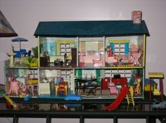 My vintage dollhouse, with Renwal furniture. by margret