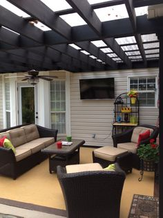 Patio furniture and pergola with roof.