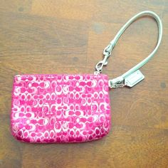Pink & silver COACH wristlet gently used Pink and silver gently used COACH wristlet. Great for a night out on the town when you don't want to bring a big bulky bag. Coach Bags Clutches & Wristlets