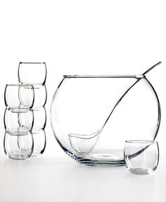 Fuel your next party with juice or sangria from this giant round punch bowl. Eight matching glasses and an accompanying ladle ensure bottomless drinks and a festive atmosphere for you and your guests.