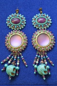 Long turquoise and lilac embroidered earrings with skulls. €54,00, via Etsy.