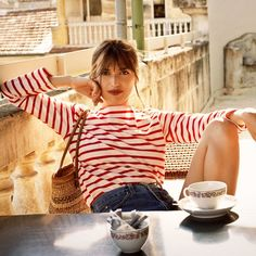 Jeanne Damas for the Reformation. Photo courtesy of the brand.-Wmag. I love the red Breton stripes paired with this dark denim. Match made in heaven.