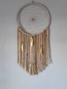 This beautiful dreamcatcher is hand made with cream thread and ribbons of different shades of cream tapes made of cotton, wool, satin, beads and golden feathers measuring 40 cm in diameter of the hoop by 90 cm long Feather, Artisan, Etsy, Wool, Beautiful, Creative, Dream Catchers, Handmade, Hair