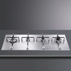 Smeg offers the four burner in-line gas hob in a stainless steel finish. It measures wide by deep and comes with front mounted controls. Cheap Appliances, Kitchen Appliances, Kitchens, Kitchen Dinning, Kitchen Sets, Dining, Cooktops, Sydney, Houses
