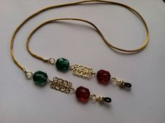 Red and green gemstone cut beads with gold aluminum filigree rectangles. $12.00 on EBay. Eyeglass Holder, Green Gemstones, Diy Necklace, Amalfi, Leather Jewelry, Eyeglasses, Jewelry Bracelets, Jewelry Accessories, Handmade Jewelry