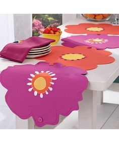 Wildflower Runner Set Seen on Zulily- the flowers button together for a runner or individual place mats. So cute and clever!
