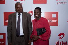 Managing Director of Airtel Ghana, Lucy Quist and The Managing Director of the Bank, Mr. Lekan Sanusi interacting during the event