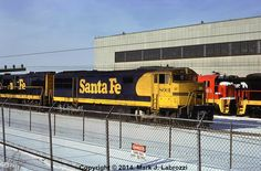 "Originally built for the Santa Fe Railway as U30CG, #401, in October 1967, ATSF #8001 now sits behind the GE Plant in Erie, PA as a ""trade-in"" locomotive on January 20, 1981.  Photo by Mark J Labrozzi."