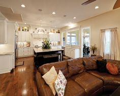 love the open living area into the kitchen with the leather couch