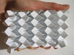the sculptural works of Polly Verity of Polyscene, who uses predominantly polypropylene to create these intricate pleatings.