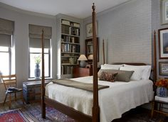 Gentlemen's Bedroom- Study in Grey with multiple and varied antique rug dimensions and inclusion of the client's family antiques. John Douglas Eason Interiors