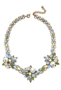 With a fresh pick of summer colors, this dazzling combination of pale blue, green and yellow hued gems is accented with shimmering crystals for a modern take on a classic floral ensemble. Shop this necklace and discover more styles at Jeweliq.com