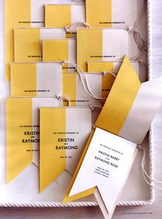nautical yellow and white flags for wedding programs