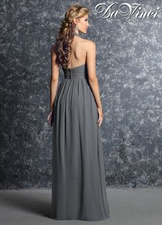 DaVinci Bridesmaids Style 60233 Chiffon halter neckline with pleated bodice and empire waist. Aline skirt is pleated at the waist and has an open back.