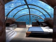 Jules Undersea Lodge - Key Largo, Florida    Jules Undersea Lodge is 21 feet under the ocean's surface, and you'll enter the lodge through an opening in the hotel floor.    Originally an underwater research laboratory, the lodge rests in a mangrove lagoon, which serves as a natural nursery for reef fish like parrotfish, snapper, tropical angelfish, oysters, and anemones.    Guests at the lodge are allowed an unlimited number of tanks for the hotel-provided scuba gear.
