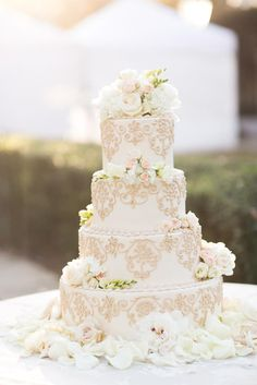 Elaborate white wedding cake. Photo by Taylor Lord Photography.