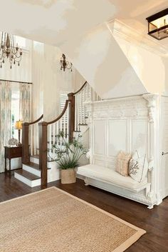 love this built in at base of stairs ... and dark wood floors and white molding details