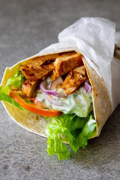 Creamy tzatziki grilled chicken wraps are delicious for a quick and easy lunch. #chickenwrap #tzatziki