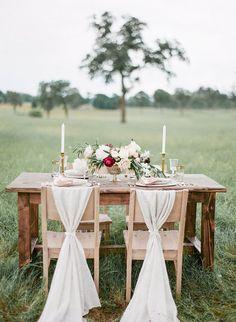 Romantic table set in field