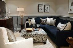 Have you thought about utilizing two neutral colors in one room? If not, try gray and beige. Two very neutral colors, but together complement each other nicely with just the slight amount of contrast. The navy blue sectional and print ottoman provides the color in the room without it being overbearing!