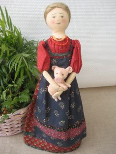 Original+textile+decoration+Doll+girl+with+a+pig.+by+TinaVanDijk