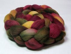 I can't spin yarn but can you imagine what a gorgeous piece this hand dyed roving would make!