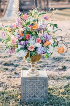 Soft purple orange & ivory florals with gold vase and wild branches from an eclectic, outdoors wedding styled shoot in Virginia with royal blue, gold & glitter. Images by A Muse Photography. Styled by Amore Events.
