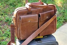 """Top Brown TaboLap Leather Laptop Bag. All TaboLap bags have 2 front pockets, 2 interior pockets, and 1 back pocket, and can store up to 15"""" laptop."""