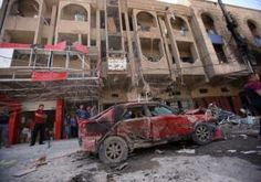 At least 71 people were killed and 201 wounded in a series of bombings and other attacks across Baghdad on Wednesday, police and medical sources said, extending the worst wave of sectarian bloodshed in Iraq for at least five years.