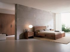 Like the idea of use of space when the walk-in/through closet and/or ensuite is behind the bed, allowing the bed to face the windows/doors (more wall space for windows and glass doors) - not looking anything like this though