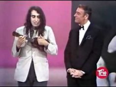 Should also post in Funnies...this is a classic! LOL    Tiny Tim - Tip Toe Through The Tulips (Live).mp4