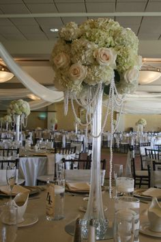 Eiffel tower vases with baby\'s breath and pearls #glencliffmanor ...